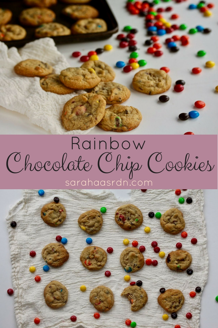 Sometimes you need to feel like a kid. That's why you need colorful chocolate covered candies in your cookies. Made with a little dose of whole grains and a little less sugar than other cookies, these Rainbow Chocolate Chip Cookies make the perfect sweet treat. @cookinRD | sarahaasrdn.com