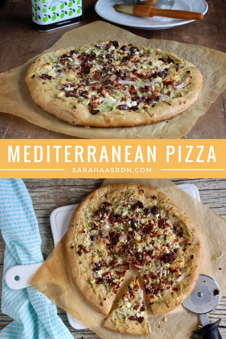 Looking for a fun, new way to enjoy pizza? Try this Mediterranean Pizza which starts with a layer of hummus and gets topped with tons of fresh veggies, feta cheese and olives! @cookinRD | sarahaasrdn.com
