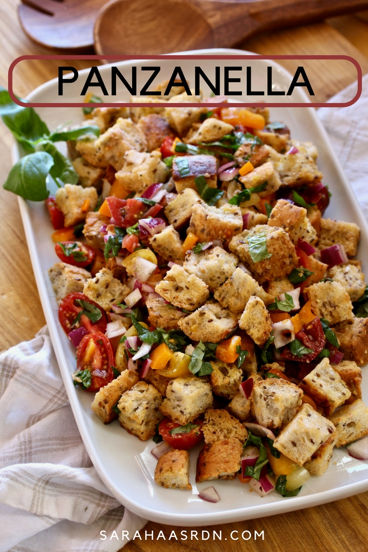 Panzanella, a delightful bread salad made with chewy whole grain baguette tossed with fresh tomatoes, basil and a simple vinaigrette. @cookinRD | sarahaasrdn.com