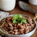 Boring beans? Not these Bacon Borracho Beans! Dry beans are transformed into something magical when infused with bacon and garlic! @cookinRD | sarahaasrdn.com