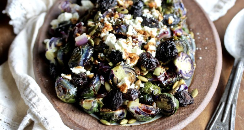 The perfect side dish to any holiday meal! These Roasted Brussels Sprouts are festively topped with dried cherries, toasted pumpkin seeds and balsamic reduction! @cookinRD | sarahaasrdn.com
